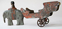antique toy elephant with a cart
